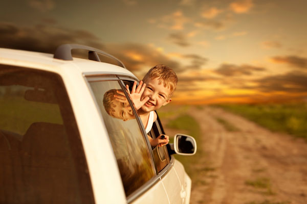 kid_waving_out_window